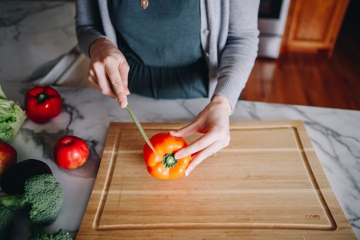 Kelsey cutting vegetables | Simply Nourished Home