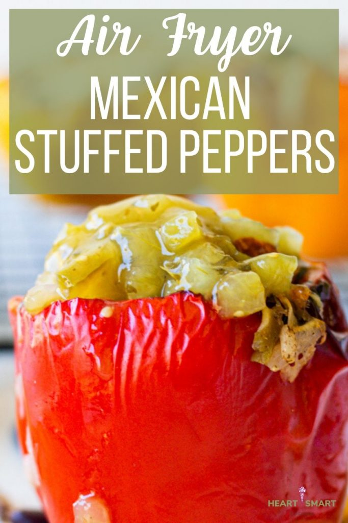 Air fryer Mexican stuffed peppers on top. Large red stuffed pepper topped with salsa